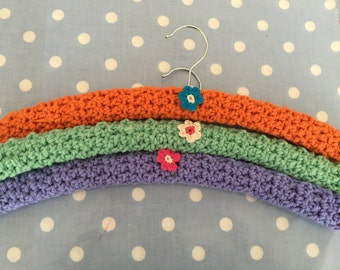 3 large crochet   covered hangers with pretty little crochet flowers