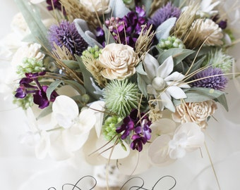 Amy - Bridal bouquet, country garden.  Cream, mauve and green.  Thistle, lilac, flannel flowers, berries, wheat, sola flowers and foliage.