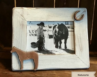 Picture frame with horse and horseshoe silhouettes