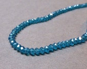 Sparkly Faceted Glass Rondelles. Medium Teal. AB Finish. 3mm. Approx. 10 Inch Strand. One (1).