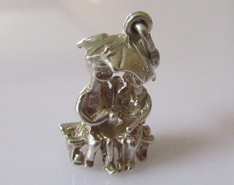 Silver Couple Under Umbrella on Bench Charm