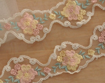 Lace trim with floral embroidery , pink, green, orange  2 yards