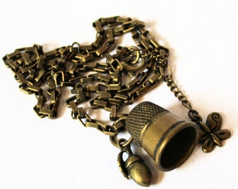 Peter Pan Necklace Acorn and Thimble Kisses Necklace Brass