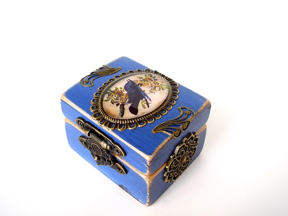 the engagement ring box in blue poe by