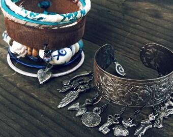 Gypsy bangle stack | Boho bangle set, Milagros charms, Silk wrapped, Gypsy bangle set, Layering bangles, Silver and blue