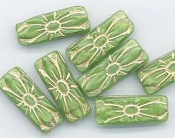 Seven Czech pressed glass beads - grass green with embossed gold - 20 x 8 mm