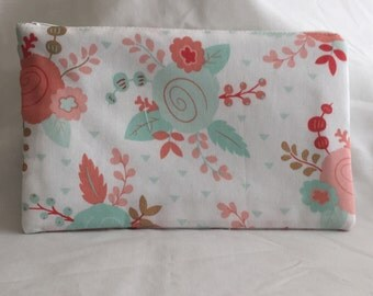Flowered pouch with polka dot lining