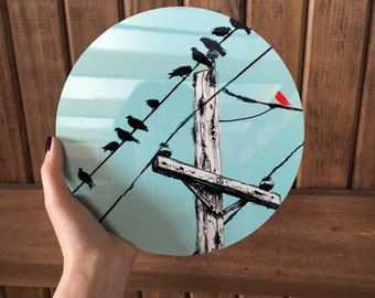 Assimilate- Illustration of Birds on a Wire on Round Metal