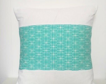 White square pillow with print fabric panel