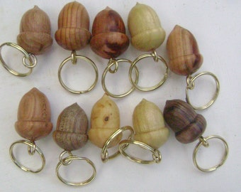 10 small wooden acorn keyrings in different woods