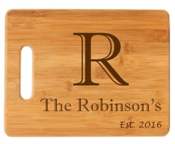 Wooden cutting board last name design for Last name pictures architecture