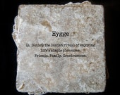 "Hygge definition - tumbled tile coasters measuring 4"" x 4""."
