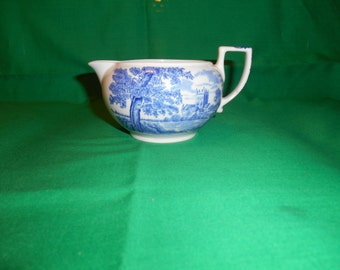 "One (1), 2 3/8"", 3 oz Creamer, from Wedgwood, in the Romantic England Blue Pattern."
