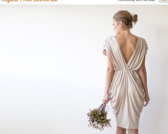 Champagne knee length bridesmaids dress, with short sleeves
