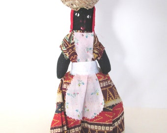 Jamiacan folk art doll, collector art doll with stand
