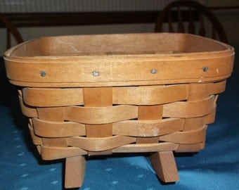 Longaberger Cradle Basket, seven by five by five inches, medium brown