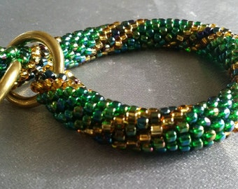 "Beaded bracelet, 8.5"", Iridescent green, gold crocheted beadwork rope, with gleaming bronze rings (#1271)"