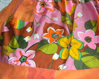 Vintage half apron pretty orange pink bright floral home sewn patched psychedelic garden party apron