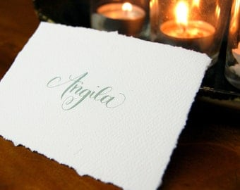 deckle edge table card with hand calligraphy