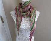 Hand knit green, red, pink, and dark grey hitchhiker scarf