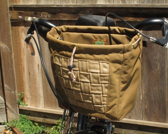 Large handlebar bag with backet weave in brown and tan.