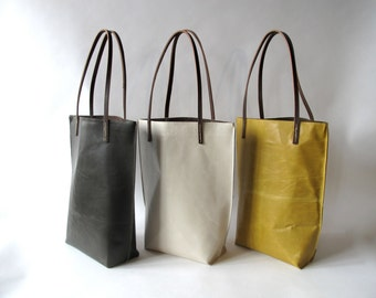 Clean modern simple hand made calf skin leather tote