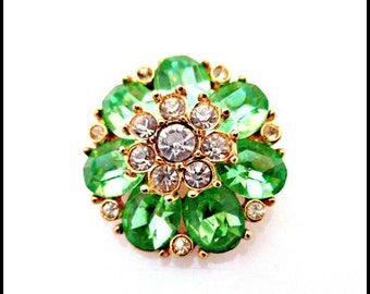 Rhinestone Flower Brooch Green and clear stone is gold setting mid century