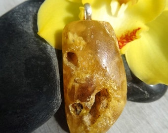 Amber pendant with sterling silver pendant bail.