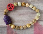 Small Purple Buddha Beaded Stretch Bracelet with Stone-Like Beads and Peace Sign