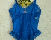 vintage 1980s bright blue teddy with garters