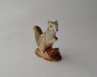 Vintage kitsch porcelain squirrel with nut figurine