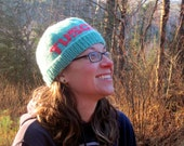 Turquoise Hand Knit Tuscarora Hat Beanie with Pink Lettering