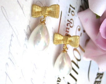 Matt gold ribbon bow earring studs with tear drop ivory South Sea shell pearls