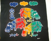 HIPPOS ON BATIK - Humorous hippos looking at us - Yellow, blue, green, gold on black - My familiy loves this batik!