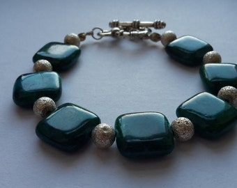 Green square and sparkly silver bracelet