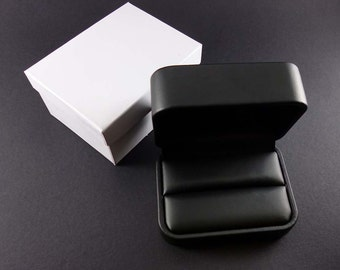 Black leatherette jewelry gift box for cuff links.