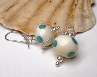 lampwork earrings, ivory and turquoise polka dots.