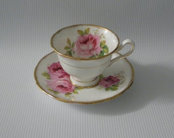 Footed Cup & Saucer Set in American Beauty (White Background) by Royal Albert