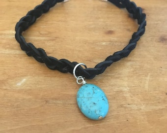 Black suede braided bracelet with Turquoise bead charm.