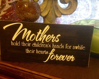 Mother's hold their children's hands for awhile, their hearts forever