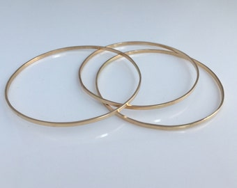 14k Gold Skinny Bangle Stacking Bracelets.  Eco friendly jewelry.