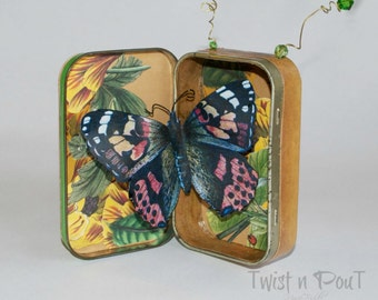 Chrysalis and butterfly altered altoids tin