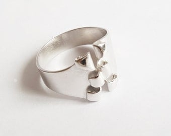 torn silver ring