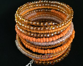 Orange wrap bracelet with key charm