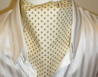 Cream / pale yellow cravat with a delicate black pattern.  Wedding cravat. Item No. LDC0059