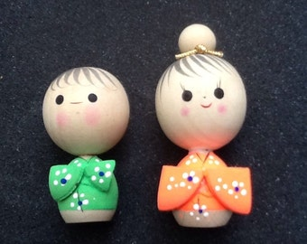 1950's set of Japanese wooden kokeshi figures with awesome florescent style color robes.