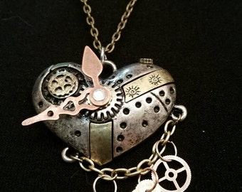 Multi strand Steampunk heart pendant with clock hands