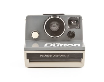 POLAROID SX70 the BUTTON Grey Instant Camera - Tested - Guaranteed Working classic polaroid design