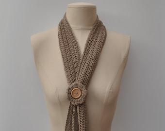 Lightweight crocheted light brown scarf