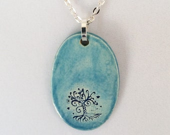 """Light Blue Ceramic Pendant with Tree of Life on a silver plated 18"""" necklace"""